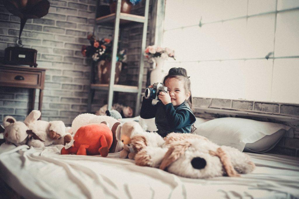 Baby with plenty of teddies